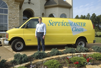 servicemaster tech standing in front of wichita home