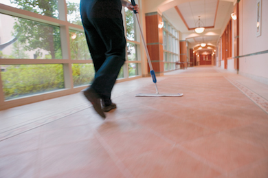 commercial tile floor cleaning being mopped