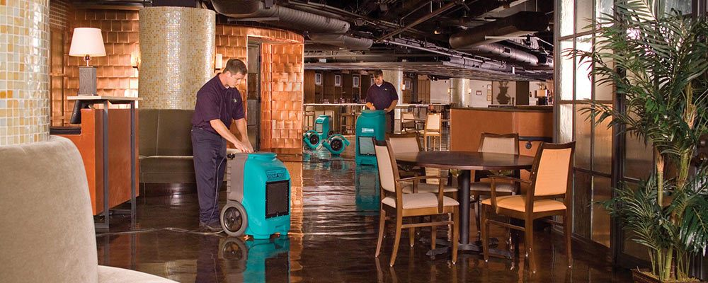 ServiceMaster technicians cleaning up flooded restaurant